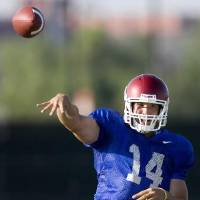 Photo - Oklahoma's  Sam  Bradford throws during an OU football practice in Norman, Okla., Thursday, August 13, 2009. Photo by Bryan Terry