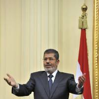 Photo - In this image released by the Egyptian Presidency, Mohammed Morsi addresses the newly convened upper house of parliament in Cairo, Egypt, Saturday, Dec. 29, 2012.  Egypt's Islamist president warned against any unrest that could harm the drive to repair the country's battered economy in his first address before the newly convened upper house of parliament on Saturday, urging the opposition to work with his government. In the nationally televised speech, Mohammed Morsi said the nation's entire efforts should be focused on