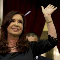Photo - Argentina's President Cristina Fernandez waves to supporters after entering the chamber of the Argentine National Congress in Buenos Aires, Argentina, Friday, March 1, 2013. Fernandez was on hand to inaugurate the 2013 opening legislative session. (AP Photo/Victor R. Caivano)