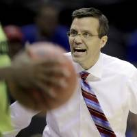 Photo - Nebraska coach Tim Miles yells at an official during the first half of a second-round game against Baylor in the NCAA college basketball tournament Friday, March 21, 2014, in San Antonio. (AP Photo/Eric Gay)