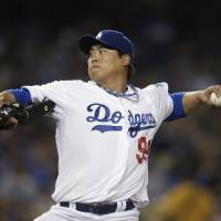 Photo - Los Angeles Dodgers starting pitcher Hyun-Jin Ryu, of South Korea, throws to the San Francisco Giants during the second inning of a baseball game in Los Angeles, Tuesday, April 2, 2013. (AP Photo/Jae C. Hong)