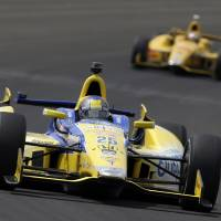 Photo - Marco Andretti leads Ryan Hunter-Reay through the first turn during practice for Indianapolis 500 IndyCar auto race at the Indianapolis Motor Speedway in Indianapolis, Monday, May 12, 2014. (AP Photo)