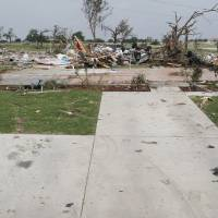 Photo - An empty driveway leads to what was once a home, with only the slab left of a house swept off of its foundation by a tornado, in Granbury, Texas, Thursday, May 16, 2013. A rash of tornadoes slammed into several small communities in North Texas overnight, leaving at least six people dead, dozens more injured and hundreds homeless.  (AP Photo/The Fort Worth Star-Telegram, Paul Moseley)  MAGS OUT; (FORT WORTH WEEKLY, 360 WEST)