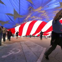 Photo - Boy Scouts carry a giant American flag in the 89ers Day Parade in Guthrie, OK, Saturday, April 20, 2013,  By Paul Hellstern, The Oklahoman