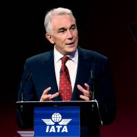 Photo - International Air Transport Association director Tony Tyler speaks during the the IATA's annual meeting held this year in Doha, Qatar, Monday, June 2, 2014. Tyler says the group will prepare a draft of new recommendations in September to improve global tracking capabilities in the aftermath of the disappearance of Malaysia Airlines Flight 370. (AP Photo/Osama Faisal)