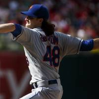 Photo - New York Mets' Jacob deGrom pitches during the fifth inning of a baseball game against the Philadelphia Phillies, Saturday, May 31, 2014, in Philadelphia. (AP Photo/Chris Szagola)