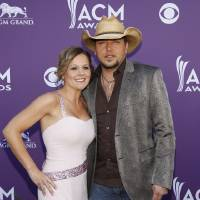 Photo -   Jason Aldean, left, and Jessica Aldean arrive at the 47th Annual Academy of Country Music Awards on Sunday, April 1, 2012 in Las Vegas. (AP Photo/Isaac Brekken)