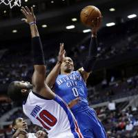 Photo -   Oklahoma City Thunder guard Russell Westbrook (0) drives on Detroit Pistons center Greg Monroe (10) in the first half of an NBA basketball game in Auburn Hills, Mich., Monday, Nov. 12, 2012. (AP Photo/Paul Sancya)