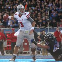 Photo -   UNLV's Nick Sherry, left, is pressured by Boise State's Tyler Horn before throwing an incomplete pass an NCAA college football game Saturday, Oct. 20, 2012, in Boise, Idaho. (AP Photo/Idaho Statesman, Joe Jaszewski) LOCAL TV OUT (KTVB 7)
