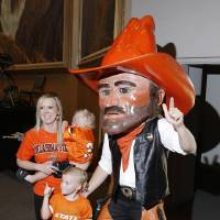 Photo - Cashion residents Amanda Hardaway and her children, Sam, 22 months and Jack, 4, pose with Pistol Pete during the OSU Cowboy Caravan at the National Cowboy and Western Heritage Museum Tuesday, August 5, 2014. Photo by Doug Hoke, The Oklahoman