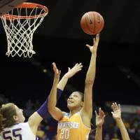 Photo - Tennessee center Isabelle Harrison (20) shoots over LSU forward Theresa Plaisance (55) in the first half of an NCAA college basketball game in Baton Rouge, La., Thursday, Feb. 27, 2014. (AP Photo/Tim Mueller)