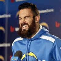 Photo - San Diego Chargers free safety Eric Weddle reacts to a question during news conference covering the Chargers' upset playoff victory over the Cincinnati Bengals and the teams' upcoming playoff game against the Denver broncos at a news conference Monday, Jan. 6, 2014, in San Diego. (AP Photo/Lenny Ignelzi)