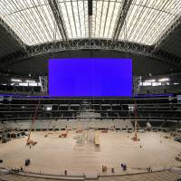 Photo - CONSTRUCTION / NFL FOOTBALL / DALLAS COWBOYS: This is to shoot a photo of the scoreboard at the new Cowboys Stadium in Arlington to use as a graphic for the Monday Work & Money centerpiece. Shot Thursday, April 2, 2009 in Arlington.  (Fort Worth Star-Telegram/Max Faulkner) ORG XMIT: M0904021543485209