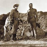 Photo - Clayton Moore, left, as the Lone Ranger, and Jay Silverheels as Tonto in an episode of the 1949-57 TV series,