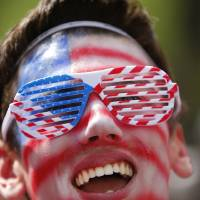 Photo - United States fan Joe Trombley, of Farmington, Mich., reacts while watching the 2014 World Cup soccer match between the United States and Belgium at a public viewing party, in Detroit, Tuesday, July 1, 2014. (AP Photo/Paul Sancya)
