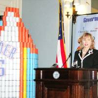 Photo - Gov. Mary Fallin announces Tuesday that enough food and money have been raised to provide about 1.6 million meals for Oklahomans. She stands next to an Oklahoma City Thunder-based sculpture made by students from Bishop McGuinness Catholic High School, who donated more than 80,000 pounds of food items.  Photo BY MICHAEL MCNUTT, THE OKLAHOMAN