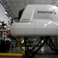 Photo -  An American Airlines Boeing 787 flight simulator is seen May 9 in Fort Worth, Texas. In the next few months, dozens of American Airlines pilots will sit in the simulator and learn the nuances of the controls before they can fly the real plane, which the airline will begin using for passenger flights early next year. AP Photo   LM Otero -  AP