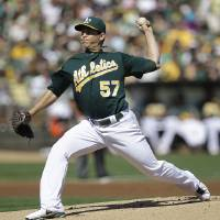 Photo -   Oakland Athletics' Tommy Milone works against the Seattle Mariners in the first inning of a baseball game Sunday, Sept. 30, 2012, in Oakland, Calif. (AP Photo/Ben Margot)