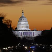 Photo - The sun rises over Capitol Hill looking down Pennsylvania Avenue in Washington, Monday, Jan. 21, 2013, as Washington prepares for the 57th Presidential Inaugural and the ceremonial swearing-in of President Barack Obama's second term. (AP Photo/Alex Brandon)