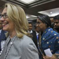 Photo -   U.S. Secretary of State Hillary Rodham Clinton, left, and Bangladesh Foreign Minster Dipu Moni leave after a joint press conference in Dhaka, Bangladesh, Saturday, May 5, 2012. Clinton is in Bangladesh to press tolerance, democracy and development in one of the world's most impoverished nations that is now in the throes of political turmoil. (AP Photo/Pavel Rahman)