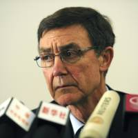 Photo - Former Australian defense chief Angus Houston, who heads the joint agency coordinating the multinational search effort for the missing Malaysia Airlines Flight 370, speaks at a press conference in Perth, Australia, on Tuesday, April 1, 2014. Australia will deploy a modified Boeing 737 to act as a flying air traffic controller over the Indian Ocean to prevent a mid-air collision among the aircraft searching for the Malaysia Airlines jetliner that went missing over three weeks ago, Houston said Tuesday. (AP Photo/Greg Wood, Pool)