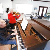 Photo - Ron and Vivian Waddell play music at their home at Touchmark at Coffee Creek in Edmond.  Photos by David McDaniel, The Oklahoman