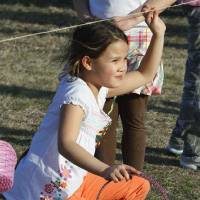 Photo - Julia Joy stakes out her place under the starting rope at Norman's annual Easter egg hunt last year at Andrews Park. This year's hunt was scheduled for last week, but was rescheduled due to poor weather. The hunt is now scheduled for Friday. OKLAHOMAN ARCHIVE PHOTO BY STEVE SISNEY  STEVE SISNEY