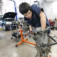 Photo - Student Chris Bobelu, of Edmond, works on a transmission Wednesday in a class at Francis Tuttle Technology Center in Oklahoma City.  Photo by Paul B. Southerland, The Oklahoman