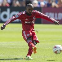 Photo - Toronto FC's Jermain Defoe scores from the penalty spot against San Jose Earthquakes during first half MLS action in Toronto on Saturday June 7, 2014.  (AP Photo/The Canadian Press, Chris Young)