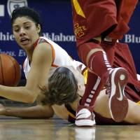 Photo - Oklahoma State's Brittney Martin (22) fights for control of a loose ball with Iowa State's Hallie Christofferson (5) during the women's college basketball game between Oklahoma State and Iowa State at  Gallagher-Iba Arena in Stillwater, Okla.,  Sunday,Jan. 20, 2013.  OSU won 71-42. Photo by Sarah Phipps, The Oklahoman