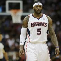 Photo - Atlanta Hawks small forward Josh Smith (5) walks down the court during the second half of an NBA first-round playoff basketball game against the Indiana Pacers, in Atlanta, Friday, May 3, 2013. (AP Photo/John Bazemore)