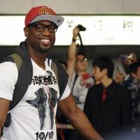 Photo -   In this photo taken Monday Oct. 8, 2012, Dwyane Wade of the Miami Heat arrives at the airport in Beijing. The Miami Heat and the Los Angeles Clippers will play two preseason NBA games in China this week. (AP Photo/Osports) CHINA OUT