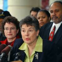 Photo -   FILE - In this April 10, 2003, file photo, Martha Burk, center, chair of the National Council of Women's Organizations, speaks to media in Atlanta while flanked by Martin Luther King III, right, and Kim Gandy, left, president of the National Organization of Women, as Burk discussed her next move in protesting the male-only membership policy of the Augusta National Golf Club. The appointment of a new chief executive at IBM has revived the debate over Augusta National's all-male membership just one week before the Masters. IBM hired Virginia Rometty as its CEO this year. The last four CEOs of IBM have been members of Augusta, but the club has never had a female member since it was founded in 1933. Burk says Augusta National and IBM now are in a bind. She says IBM could end up undermining its new CEO if it doesn't fight for her admittance. (AP Photo/Gregory Smith, File)