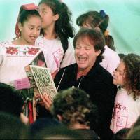 Photo - FILE - In this April 21, 1996 file photo, Robin Williams reads