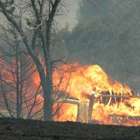 Photo - Grassfires burn near Wellston Thursday. Photo by Steve Gooch