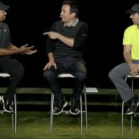 Photo - Golfer Rory McIlroy, right, listens as fellow golfer Tiger Woods, left, banters with television host Jimmy Fallon during a golfing demonstration, Monday, Aug. 18, 2014, in Jersey City, N.J.  (AP Photo/Mel Evans)