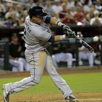 Photo - San Diego Padres' Everth Cabera connects for a two-run home run against the Arizona Diamondbacks during the third inning of a baseball game on Saturday, May 25, 2013, in Phoenix. (AP Photo/Matt York)