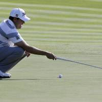 Photo - In this Aug. 25, 2013 photo, Erik Compton looks at his putt on the first hole during the final round of The Barclays golf tournament in Jersey City, N.J.