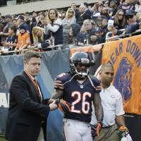 Photo - Chicago Bears cornerback Tim Jennings (26) is helped off the field by trainers after an injury in overtime of an NFL football game in Chicago, Sunday, Dec. 2, 2012. The Seahawks won 23-17 in overtime. (AP Photo/Nam Y. Huh)