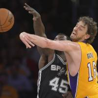 Photo - Los Angeles Lakers forward Pau Gasol, of Spain,, right, blocks a pass by San Antonio Spurs center DeJuan Blair during the first half in Game 3 of a first-round NBA basketball playoff series, Friday, April 26, 2013, in Los Angeles. (AP Photo/Mark J. Terrill)