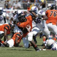 Photo - SOUL BOWL: Douglass's Chavez Wyatt (5) runs the ball during a high school football game between Douglass and Millwood in Oklahoma City, Saturday, Sept. 8, 2012.  Photo by Garett Fisbeck, The Oklahoman