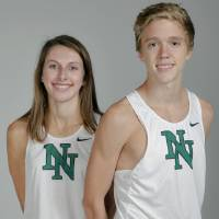 Photo - Norman North High School's all-city cross country runners of the year Ben Barrett and Belle Wallace pose for a photo in the OPUBCO studio in Oklahoma City, Okla. on Tuesday, Nov. 26, 2013.  Photo by Chris Landsberger, The Oklahoman