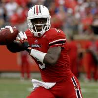 Photo -   Louisville quarterback Teddy Bridgewater looks to pass against Kentucky during first-half action during an NCAA college football game at Cardinal Stadium in Louisville, Ky., Sunday, Sept. 2, 2012. (AP Photo/Garry Jones)