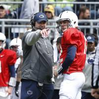Photo - Penn State head coach Bill O'Brien, left, talks with quarterback Steven Bench (12) during the first half of their spring NCAA college football game on Saturday, April 20, 2013, in State College, Pa. (AP Photo/Keith Srakocic)