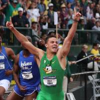 Photo - Oregon's Devon Allen celebrates after winning the men's 110-meter hurdles at the NCAA track and field championships on Saturday, June 14, 2014, in Eugene, Ore. (AP Photo/Rick Bowmer)