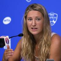 Photo - Victoria Azarenka, from Belarus, answers questions during a news conference at the Western & Southern Open tennis tournament, Sunday, Aug. 10, 2014, in Mason, Ohio. Azarenka is the defending champion at the event. (AP Photo/Al Behrman)