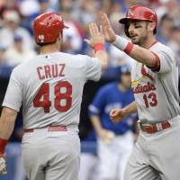 Photo - St. Louis Cardinals' Matt Carpenter, right, and Tony Cruz celebrate Carpenter's two-run home run against the Toronto Blue Jays during the second inning of a baseball game in Toronto, Sunday, June 8, 2014. (AP Photo/The Canadian Press, Frank Gunn)