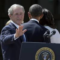 Photo - FILE – In this April 25, 2013, file photo former President George W. Bush turns to wave as he leaves with President Barack Obama and first lady Michelle Obama after the dedication of the George W. Bush Presidential Center in Dallas. Bush has successfully undergone a heart procedure after doctors discovered a blockage in an artery.  (AP Photo/LM Otero, File)