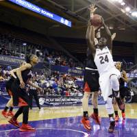 Photo - South Carolina's Aleighsa Welch puts up a shot against Cal State Northridge in the first half of a first-round game in the NCAA women's college basketball tournament, Sunday, March 23, 2014, in Seattle. (AP Photo/Ted S. Warren)