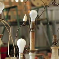 Photo - Vintage lamps are offered for sale at a recent flea market at the Cleveland County Fairgrounds, 615 E Robinson St., Norman. Dick Ross operates a flea market most Fridays and Saturdays at the fairgrounds.